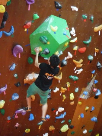 A climber at Koru Piki: Rock-Climbing Gym, Ginowan
